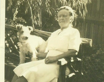 1930s Terrier Dog Old Woman Sitting Outside on Bench 30s Vintage Photograph Black White Photo