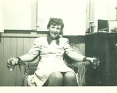 1950s Woman Holding Drinking Glass in Each Hand Sitting in Wicker Chair Party 50s Vintage Photograph Black White Photo