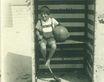 1929 Traditional German Boy At the Beach Sand Shovel Ball lederhosen 20s Vintage Photograph Black White Sepia Photo