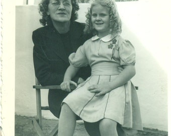 Sitting on Grandma's Lap Little Girl With Curls Outside Wood Chair 1940s Vintage Black and White Photo Photograph
