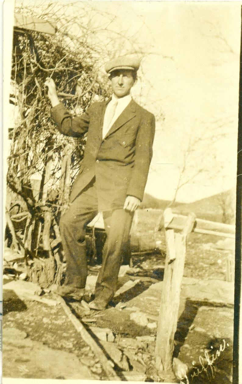1907 Oklahoma Rancher Standing With Vine Hardscrabble Dirt Farm RPPC Postcard Antique Photo Photograph