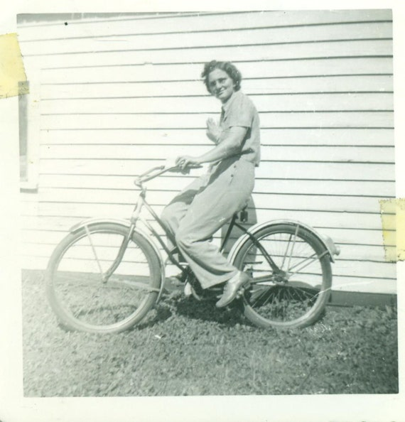 ww2 1942 wi woman riding bicycle 1940s pants world war 2