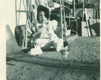 Ready for a Push Baby Girl Sitting on Wooden Rope Swing 1940s Vintage Black White Photo Photograph