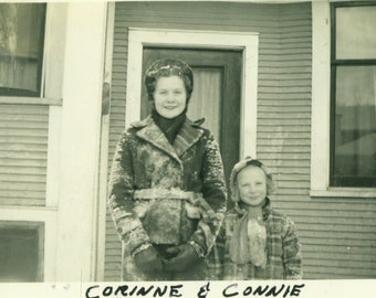 After The Snowball Fight Mother Daughter Standing on Front Porch Covered in Snow 1939  Vintage Black White Photo Photograph