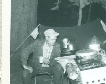 1958 The Camp Cook Man Drinking Coffee Reading Magazine Camp Stove 50s Vintage Photograph Black White Photo