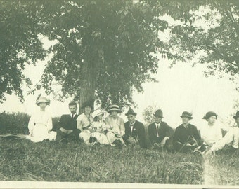 Family Gathering Summer Picnic Men Women Kids Sitting on Hill Trees RPPC Real Photo Postcard Antique Vintage Black White Photo Photograph