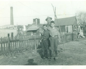 Little Cowboys Wearing Toy Gun Holsters Brothers Boys Grandfather Backyard 1950s Vintage Black And White Photo Photograph