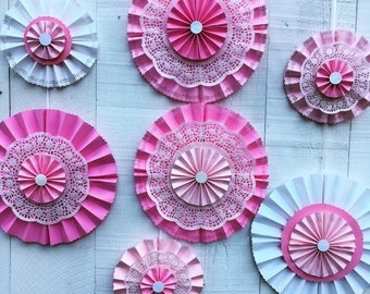 Lacy paper medallions custom made in any color for Valentine's Day, weddings, and parties