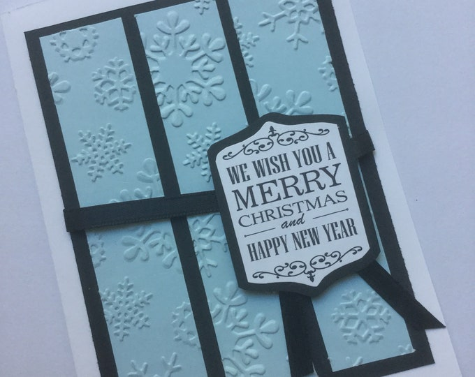Light blue and black snowflake-embossed Christmas card