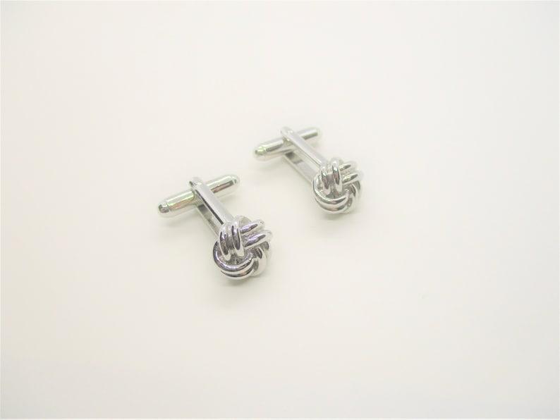 Silver knot cufflinks: Distinctive silver tone fancy knot image 0