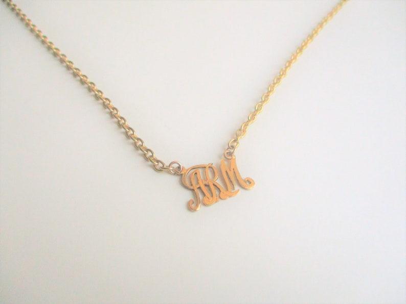 Gold initial necklace: Charming cursive ARM initial antique image 0