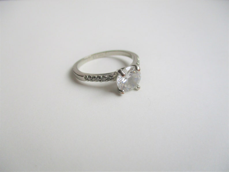 size 10 cocktail ring silver plated sparkly ring Rhinestone engagement ring: Dazzling rhinetone and silver plated engagement style ring