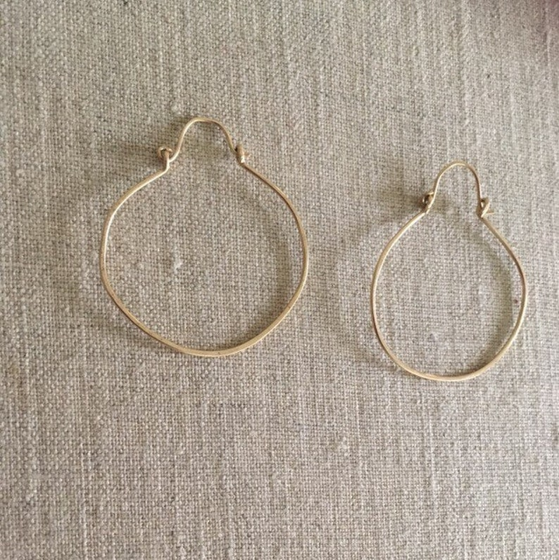 Large gold filled hammered hoops by Ankh By Racquel image 0