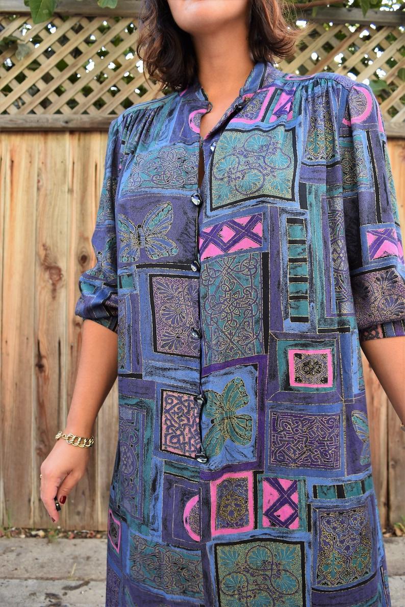 and floral appliqu\u00e9s 80s size L sweater w shoulder pads Vintage 1980s black teal and purple print sweater w sheer floral sleeves  size L