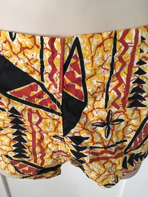 "1950s Made in California Red Yellow and Black Hawaiian Print Swim Shorts with Metal Side Zipper and Button Closure-30"" Waist"