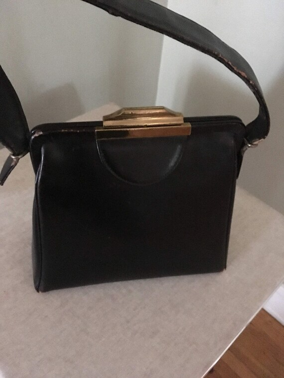 1950s Classic Black Leather Handbag with Top Metal Clasp and Attached Coin Purse