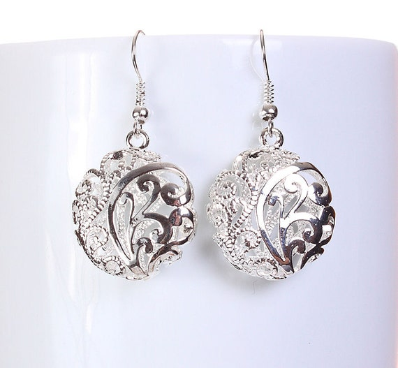 Silver tone flat round filigree drop dangle earrings (585)