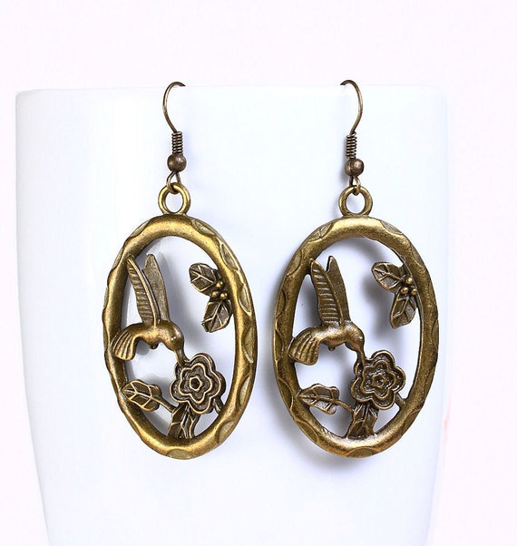 Antique brass hummingbird drop earrings (528)