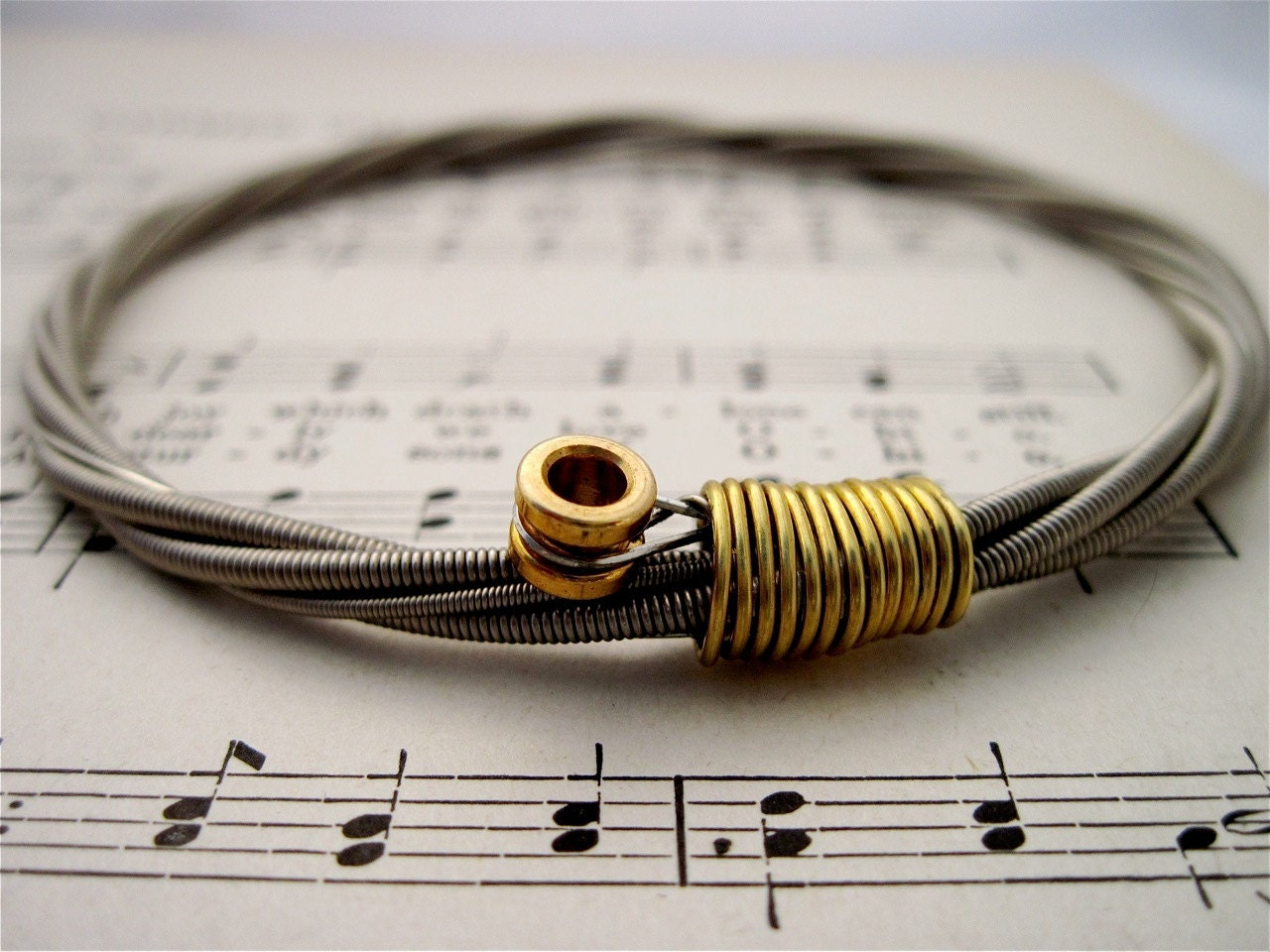 bass guitar string bracelet silver colored with brass ball end etsy. Black Bedroom Furniture Sets. Home Design Ideas