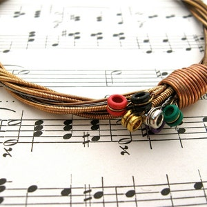 Recycled Acoustic Guitar String Bracelet gold colored with colored ball ends attached Mens or Womens Unique Musician Teacher Gift