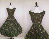 Vintage 1950s Stick Figure Farmers Novelty Print Olive Green Cotton Full Skirt Dress