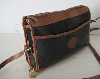 Dooney and Bourke Black and Saddle Tan leather Handbag