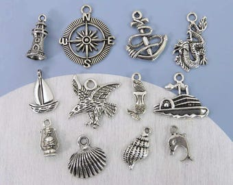 12 NAUTICAL Marine Boating Themed Silver Charms - Each Different - Lighthouse, Sailboat, Anchor, Mermaid, Shell, Compass - US Seller