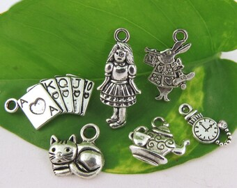 6 ALICE in WONDERLAND Theme Charms - Assorted Each One Different -Antique Silver- Collection- Cheshire Cat, Teapot, Cards, Pocket Watch