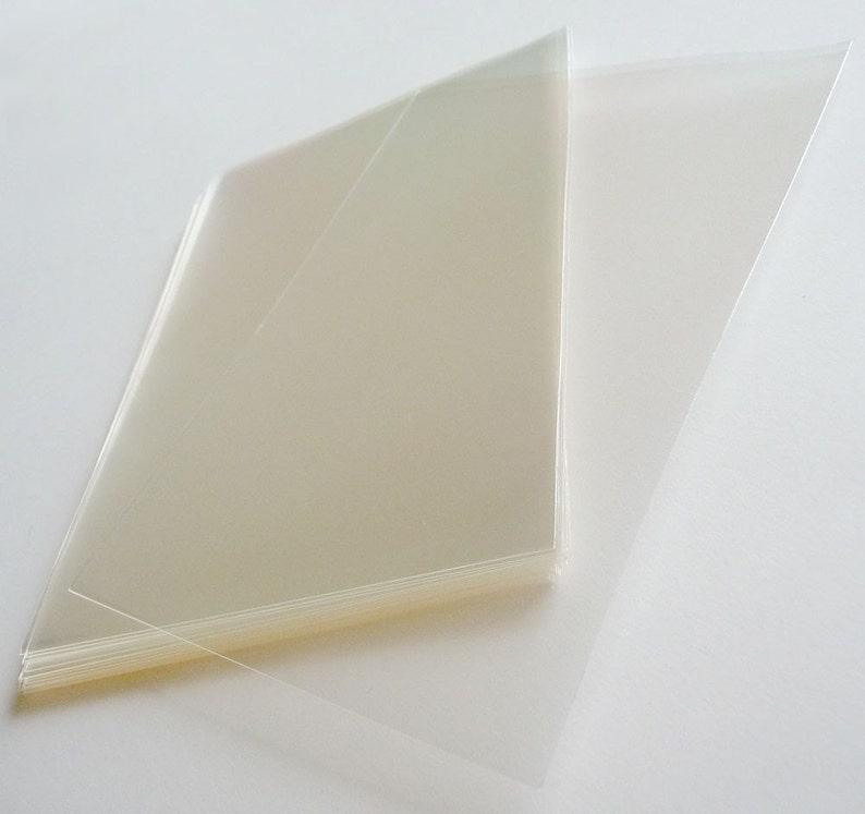 110mm X 180mm..This is not resealable self sealing bags. OPP Set of  50pcs Clear Cello Poly Bag Envelope