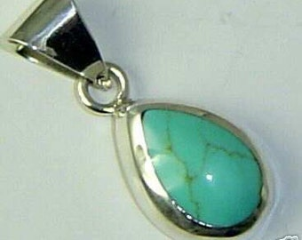 Vintage Turquoise and Sterling Silver pendant made in Mexico