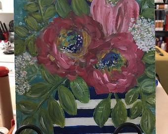 bouquet in striped vase