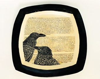 Hand-carved Ravens (or crows?) on a ceramic  art platter with definitions of ravens and crows with an antique parchment look.