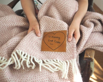 Woollen throw personalised with a leather patch engraved with your message in your handwriting. A lovely wedding or Mothers' Day gift