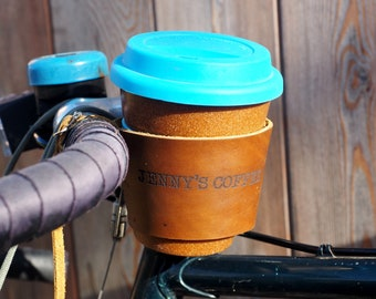 Personalized leather bike coffee cup holder with reusable cup.