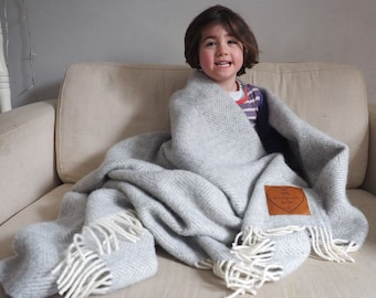Woollen throw, personalised with a message engraved on leather patch. Perfect anniversary, wedding or Mothers' Day gift.