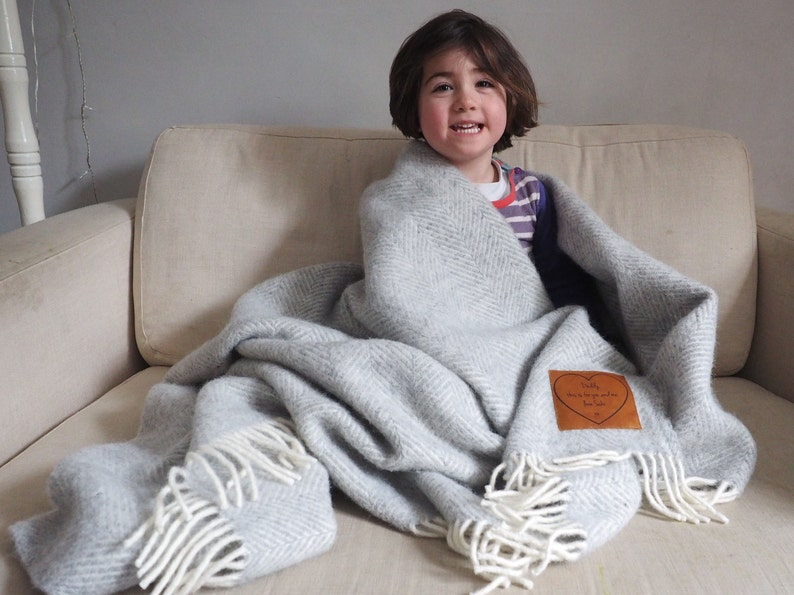 Woollen throw personalised with a message engraved on leather Silver grey & cream