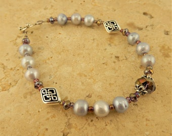 Silver Celtic Knot Bracelet with purple freshwater pearls and iridescent purple crystal beads