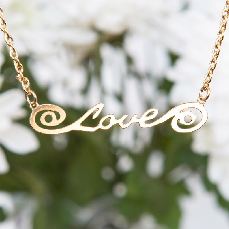 Gold necklace with the word 'Love' Script love image 0