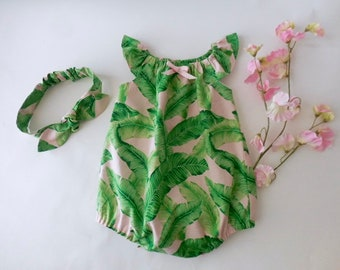 2df2f7b6cd82 Baby and toddler sunsuit romper in pink with green banana and palm leaves  with matching top knot headband