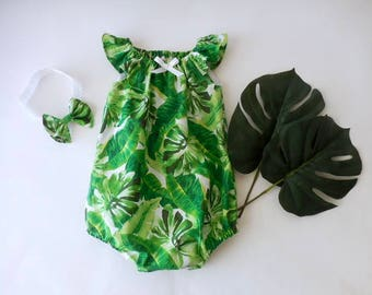 9c55c1519577 Baby and toddler sunsuit romper in green banana leaves and palm fronds with  matching headband bow