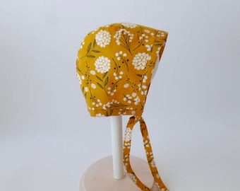 Baby and toddler bonnet- mustard gold with white flowers