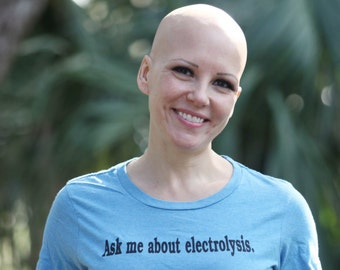 Bald ladies t-shirt. Ask me about electrolysis.
