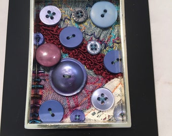 Blue button assemblage with textiles, sewing artwork, button art, textile art, textile and button assemblage art, sewing, buttons
