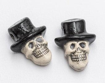 2 Halloween Skull Pendants, skeleton charms,    2mm hole,  hemp Jewelry Supplies, high fired clay