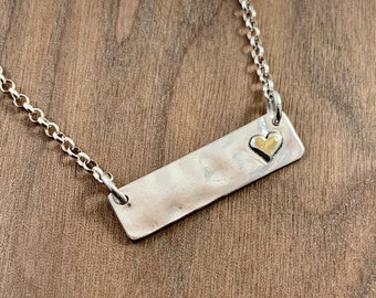 Sterling silver bar necklace with gold heart