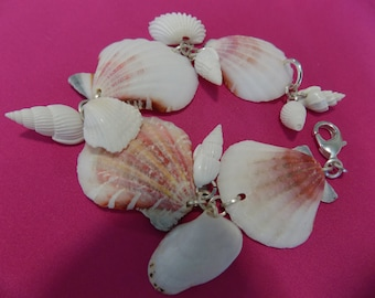 "Remember this?  ""She sells sea shells by the seashore"".  I harvested these shells to make this summer bracelet, for you?"