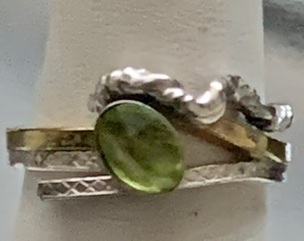 Sterling and gold multi band ring with oval Peridot gemstone