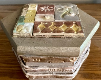 Decorative box with multiple textured clay embellishments