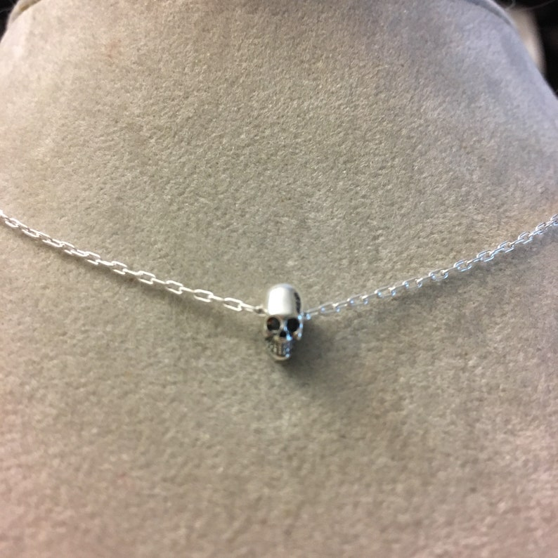Tiny skull sterling silver necklace  tiny things murderino image 0