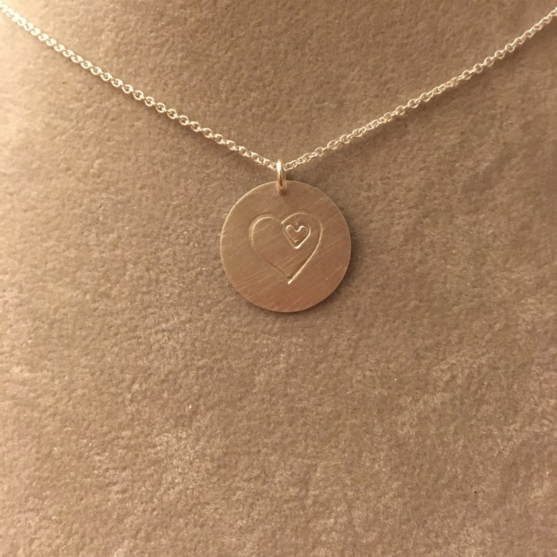 Heart within a heart hand-stamped sterling silver necklace  image 0